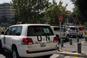 Снайперы обстреляли инспекторов ООН в Сирии Машины ООН в Дамаске Фото: AFP
