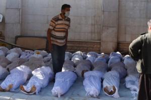 Британский флот начал подготовку к удару по Сирии Погибшие в результате химической атаки 21 августа Фото: Stringer / Reuters