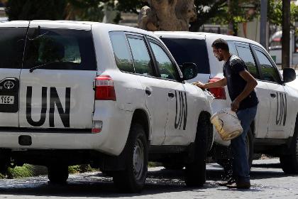 В Сирии началась ликвидация химического оружия Кортеж ООН в Дамаске Фото: Louai Beshara / AFP