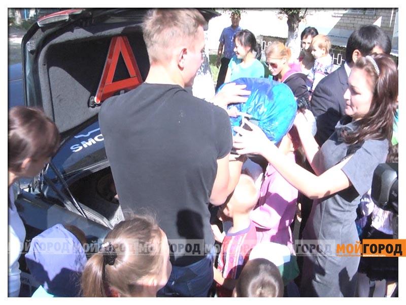 Участники автопробега в Уральске собрали помощь детдомовцам probeg6