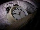 iStock_clock_in_bed_GOING_TO_BED_LATE