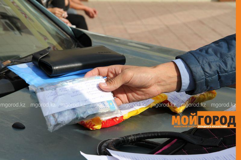 За получение взятки задержаны начальник автохозяйства департамента полиции Атырауской области и его заместитель